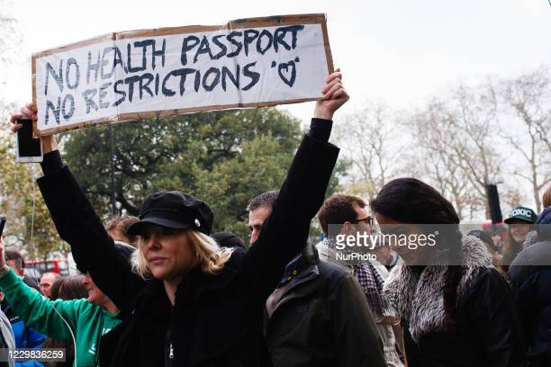 Anti-lockdown activists march from Hyde Park in London, England, on November 28, 2020. London is to return to 'Tier 2' or 'high alert' covid-19...