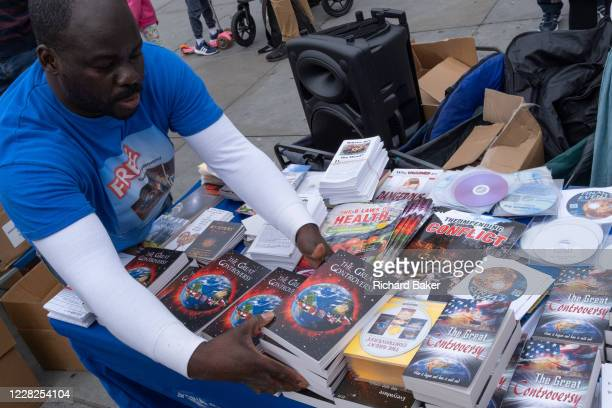 Anti-lockdown and conspiracy theory literature on sale as Coronavirus deniers protest in Trafalgar Square for personal freedoms and against the...