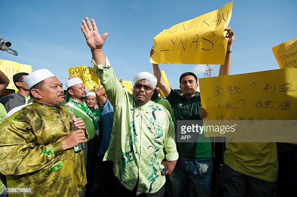 AntiLynas activists chant slogans and display placards during a Green Gathering 20 against the Lynas Corporation in Kuantan some 260 kilometres east...
