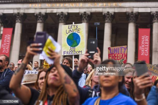 Anti-mask protesters are seen at the Unite for Freedom protest in Trafalgar Sq on August 29, 2020 in London, England. Speakers, including Jeremy...