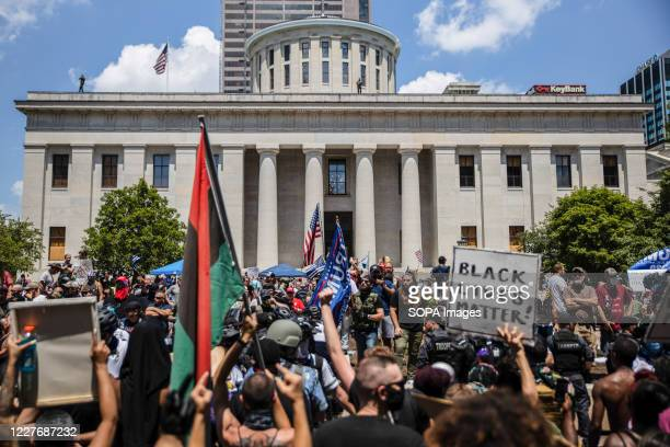 Anti-Mask protesters collide with Black Lives Matter counter-protesters during an 'Anti-Mask' rally, Black Lives Matter protest at Ohio Statehouse....