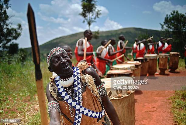 Antime Baranshakaje leader of the Gishora drumming group performs in Gishora on March 14 2015 With wild dancing to a furious beat booming wooden...