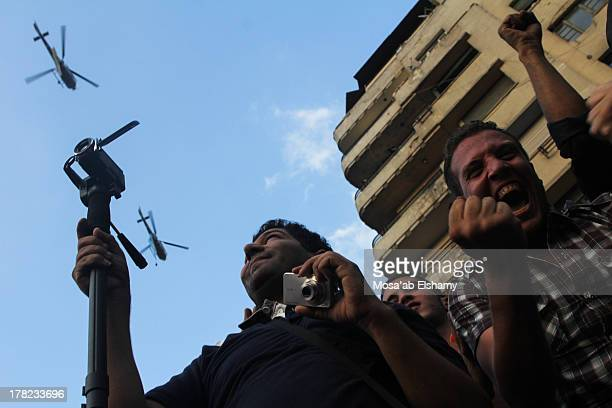 CONTENT] AntiMorsi supporters gesture during protests calling for his ouster in Tahrir square