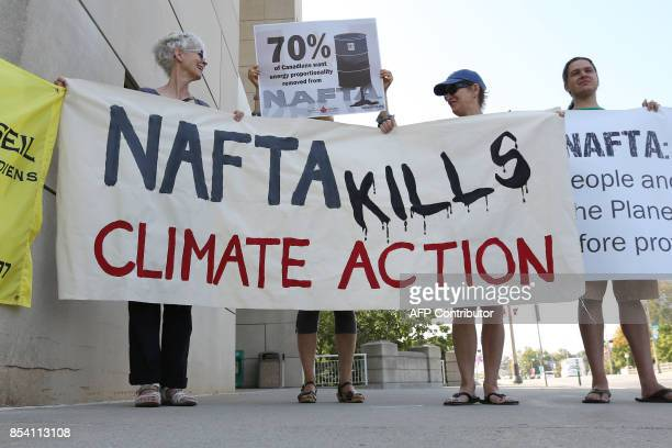 AntiNAFTA demonstrators stand outside the building where the NAFTA renegotiations are being held in Ottawa Ontario September 26 2017 The United...