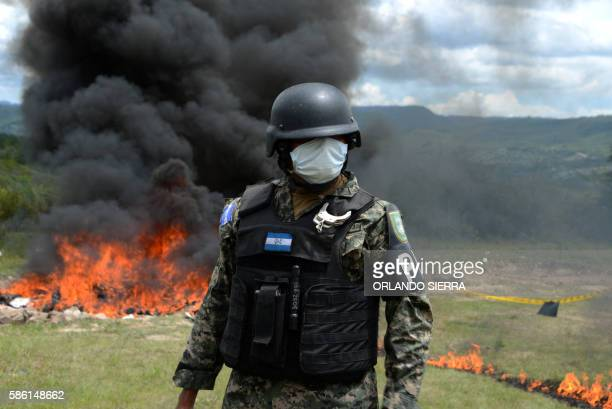 Anti-narcotics and Military Police officers incinerate more than 200 kilos of cocaine seized in southern Honduras near the border with Nicaragua, on...