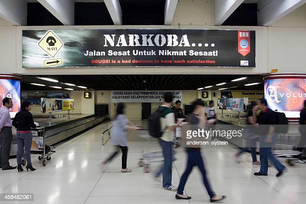 anti-narcotics banner at indonesian airport. - crack pipe stock pictures, royalty-free photos & images