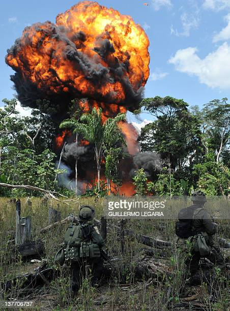 Antinarcotics police officers blow up a laboratory for processing cocaine base seized from the Revolutionary Armed Forces of Colombia in the...