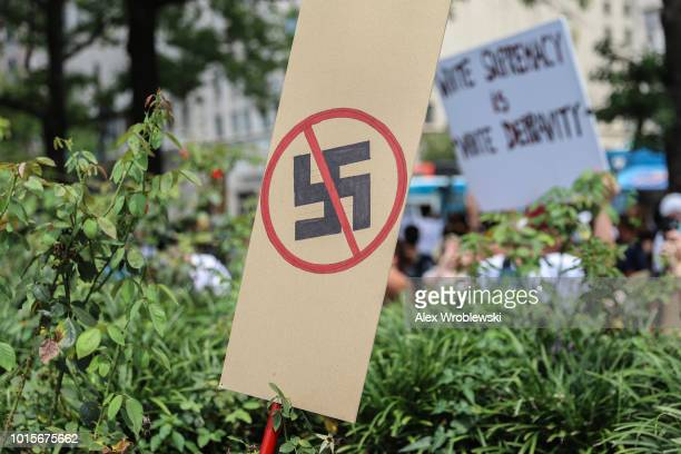 A antiNazi sign stands as counter protesters gather at Freedom Plaza before the Unite the Right rally in Lafayette Park on August 12 2018 in...