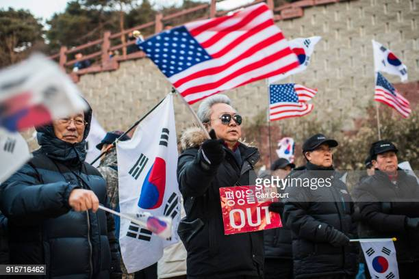 AntiNorth Korea protesters demonstrate against a performance by North Korea's Samjiyon art troupe at Gangneung Art Centre on February 8 2018 in...
