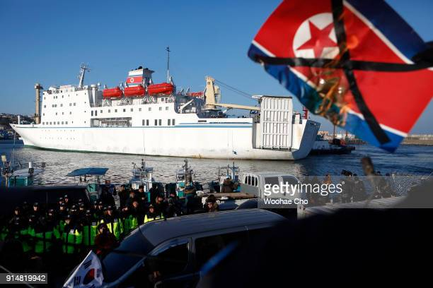 AntiNorth Korean activists burn Kim Jongun's portrait while the North Korean ferry Man Gyong Bong arrives at Mukho Port in Donghae South Korea on...