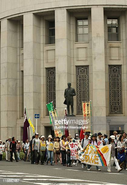 Antinuclear activisst march on the street during a protest against nuclear energy on June 11 2011 in Osaka Japan The Japanese government has been...