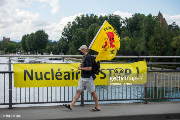 Anti-nuclear activists converging from both Germany and France meet on the Rhine bridge Breisach-Vogelgrun on the German/French border for the 480th...
