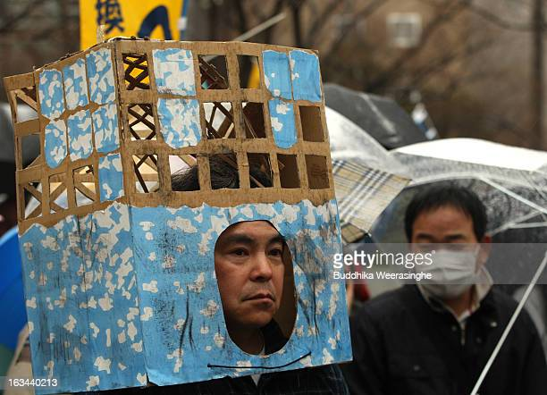 Antinuclear activists dress as Fukushima Daiichi Nuclear reactor march during an antinucler protest on March 10 2013 in Kobe Japan Japan to mark the...