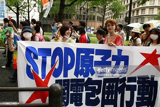 Antinuclear activists hold a poster that reads STOP NUCLEAR POWER at a protest against nuclear energy on June 11 2011 in Osaka Japan The Japanese...