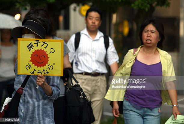 Antinuclear activists hold a protest against restarting the commercial nuclear reactors on July 27 2012 in Osaka Japan Two of Japan's commercial...