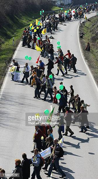 Antinuclear activists hold hands in a human chain they projected as 45km long in front of the Neckarwestheim nuclear power plant on March 12 2011...