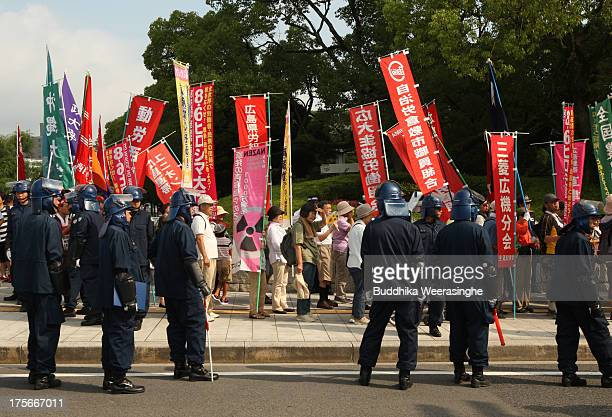 Antinuclear activists march around the Hiroshima Peace Memorial Park on the day of the 68th anniversary of the atomic bombing of Hiroshima on August...