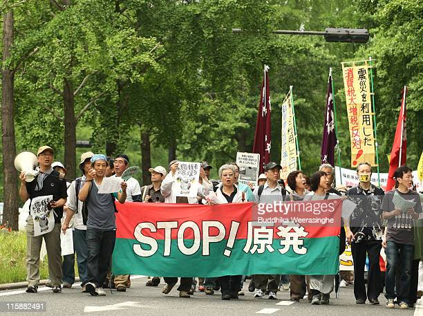 Antinuclear activists march at a protest against nuclear energy on June 11 2011 in Osaka Japan The Japanese government has been struggling to deal...