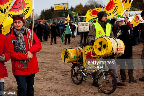 Antinuclear activists take part at a mass rally on November 26 2011 in Dannenberg Germany A train carrying the Castor containers of processed spent...