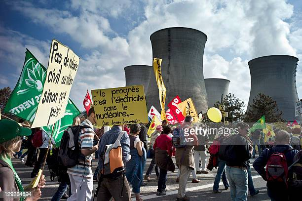 Antinuclear activists take part in a demonstration to call for the closure of France's nuclear power plants on October 15 2011 in front of the Bugey...