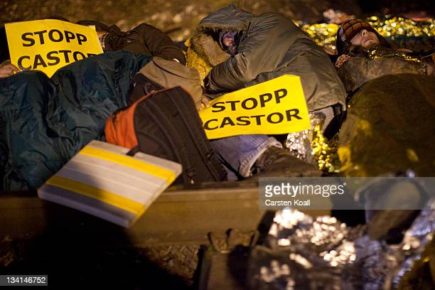 Antinuclear activists take part in a mass rally on the track that will be used to transport nuclear waste on November 27 2011 in Harlingen near...