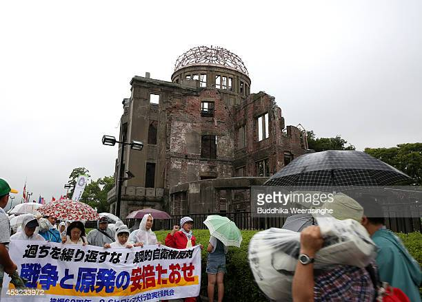Antinuclear and antiwar activists march front of the Atomic Bomb Dome at the Hiroshima Peace Memorial Park on the day of the 69th anniversary of the...