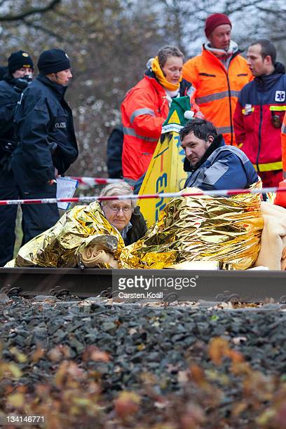 Antinuclear protesters are stuck in a concrete block they built on the track that will be used to transport nuclear waste on November 27 2011 in...