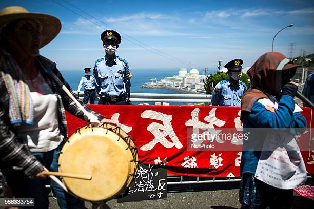 Antinuclear protesters gather in front of Ikata Nuclear Power Plant to protest against the restarting of a nuclear reactor on August 11 2016 in Ikata...