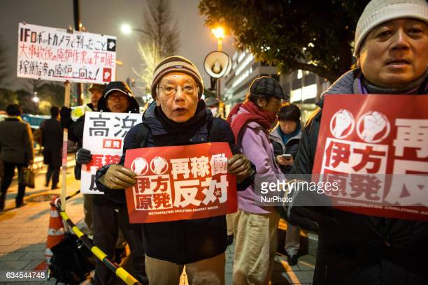Antinuclear protesters hold quotNo nukesquot placards during a protest calling Japanese government to put an end to atomic power in Japan in Tokyo...