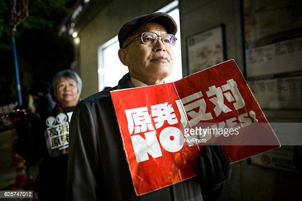 Antinuclear protesters holding a placard rallied in front of Japanese Prime Minister Shinzo Abes office in Tokyo on Friday to demand the closure of...