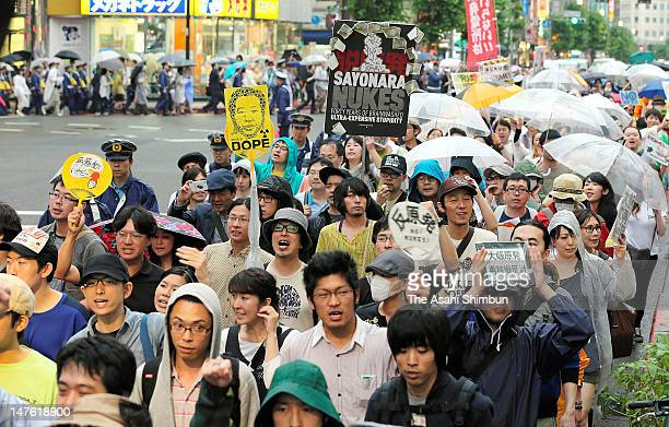 Anti-nuclear protesters march on as the Kansai Electric Power Co . Oi Nuclear Power Plant restarting process continues on July 1, 2012 in Tokyo,...