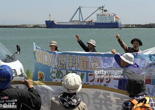 Anti-nuclear protesters stage a demonstration to protest against a MOX fuel shipment carried by French armed cargo vessel, Pacific Heron arrives at...