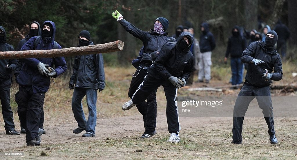 Anti-nuclear protesters throw stones at police as they try to stop the so-called castor transport train carrying nuclear radioactive waste on route to Gorleben near the northern town of Leitstade on November 27, 2011. The train, carrying 11 wagonloads of German nuclear radioactive waste, left on November 23, 2011 from a yard operated by the French nuclear giant Areva in Valognes.
