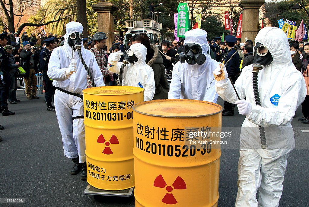Anti-nuclear protesters wearing radiation protection gears rally in front of the Diet building on March 9, 2014 in Tokyo, Japan. On March 11 Japan commemorates the third anniversary of the magnitude 9.0 earthquake and tsunami.