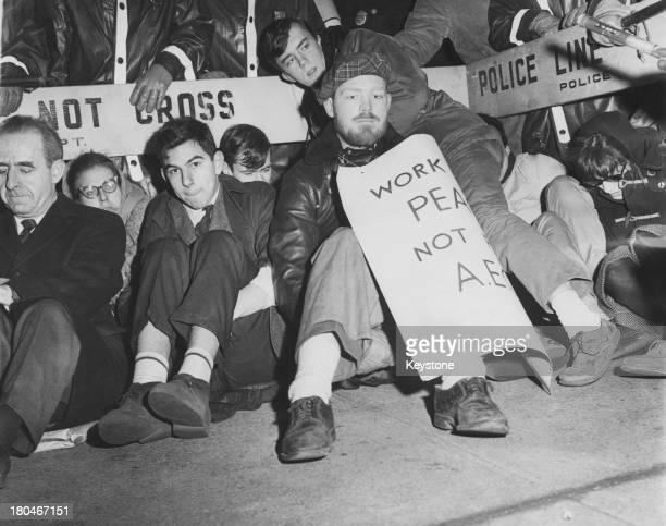 Anti-nuclear protestors, stage a sit-down protest outside the offices of the Atomic Energy Commission at Hudson Street and Houston Street in...