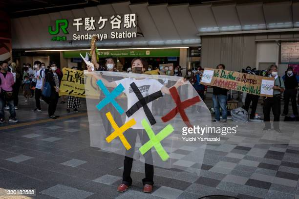Anti-Olympics protesters demonstrate against the Tokyo Olympics on July 23, 2021 in Tokyo, Japan. Protesters gathered to demonstrate against the...
