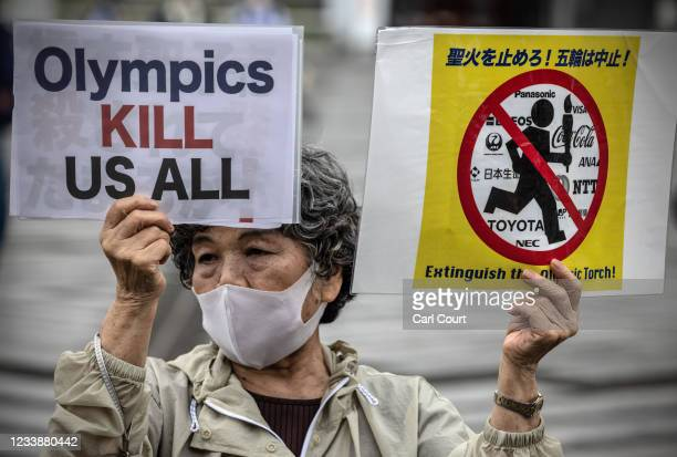 Anti-Olympics protesters demonstrate during an unveiling ceremony for the Tokyo leg of the Olympic torch relay in Komazawa Olympic Stadium on July 9,...