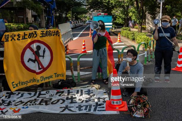 Anti-Olympics protesters demonstrate during the Olympic Torch Relay Celebration event on July 19, 2021 in Tokyo, Japan. As the Olympic torch relay...