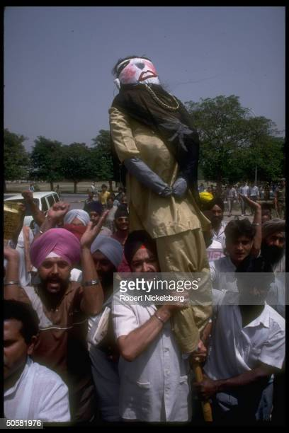 AntiPakistan demonstrators w effigy of PM Benazir Bhutto protesting Pakistan's interference in Kashmir nr Pakistani Embassy