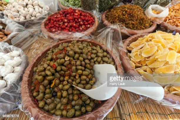 Antipasti and candied fruits at a market stall in Cannobio, Lago Maggiore, Verbano-Cusio-Ossola province, Piedmont region, Italy