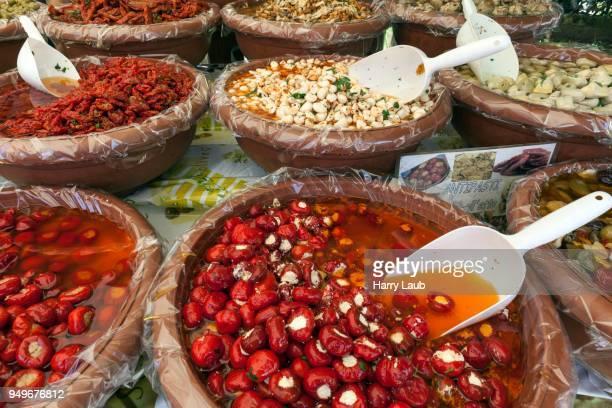 Antipasti at a market stall in Cannobio, Lago Maggiore, Verbano-Cusio-Ossola province, Piedmont region, Italy
