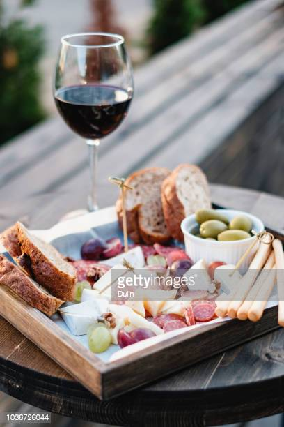 antipasto and red wine on a table - antipasto stock pictures, royalty-free photos & images