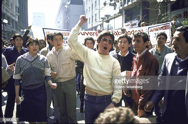 AntiPinochet Government demonstration on traditional voting day before the coup raising clenched fists
