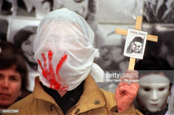AntiPinochet protestors outside the High Court in London where judgement is given in the Belgium and six human rights groups bid to challenge the...