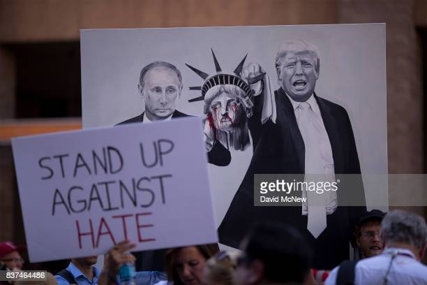 AntiPresident Donald Trump demonstrators hold a painting of Russian president Vladimir Putin and Trump outside the Phoenix Convention Center before a...