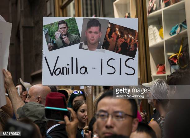 AntiPresident Donald Trump protesters carry signs of rightwing activists outside of Trump Tower August 14 2017 in New York City Security throughout...