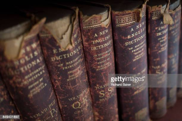 Antiquarian copies of The New English Dictionary on Historical Principles edited by Sir James Murray line shelves in the Lee Library of the British...