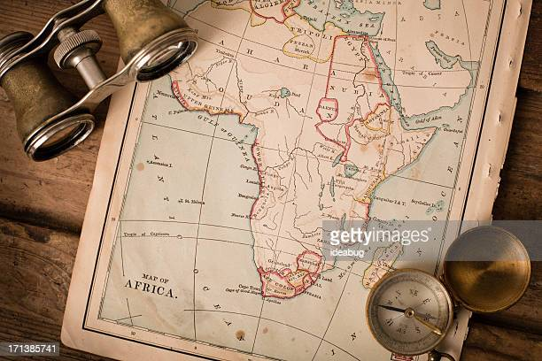 Antique 1870 Map of Africa, Binoculars, and Compass on Trunk