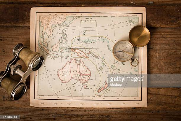 Antique 1870 Map of Australia, Binoculars, and Compass on Trunk