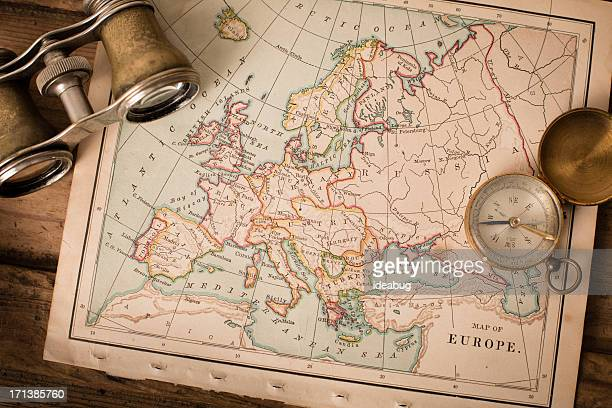 Antique 1870 Map of Europe, Binoculars, and Compass on Trunk